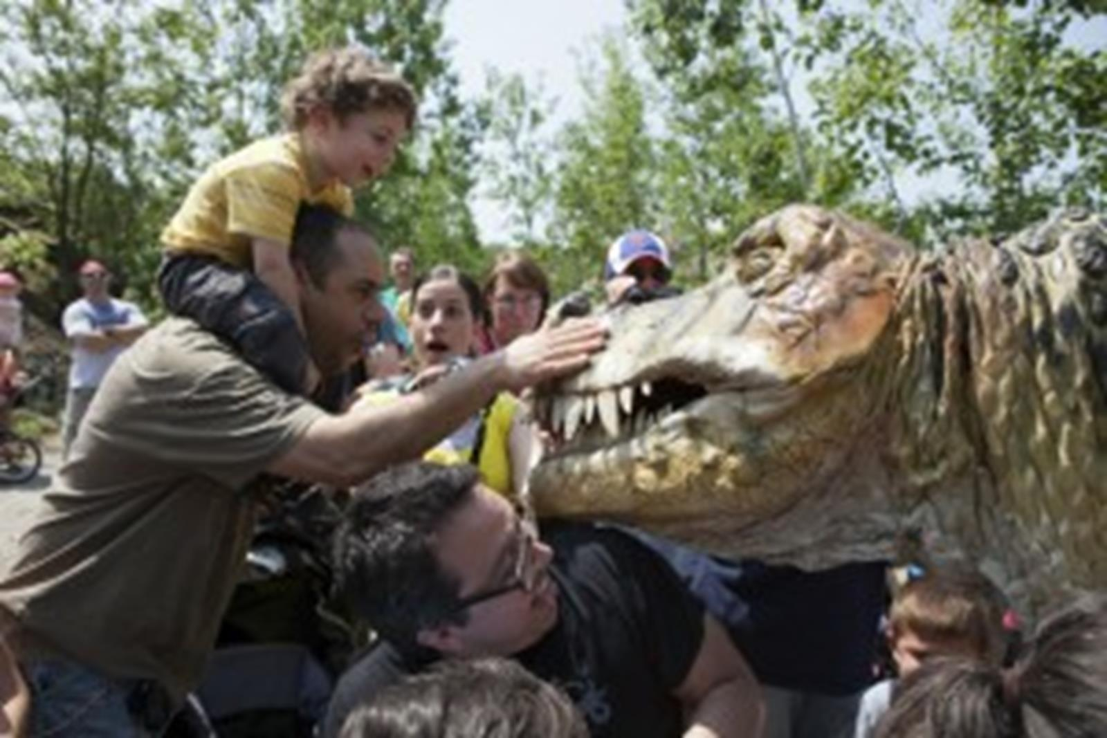 Petting the Mighty T-Rex. Puppets designed, created and provided by Erth. All rights reserved.