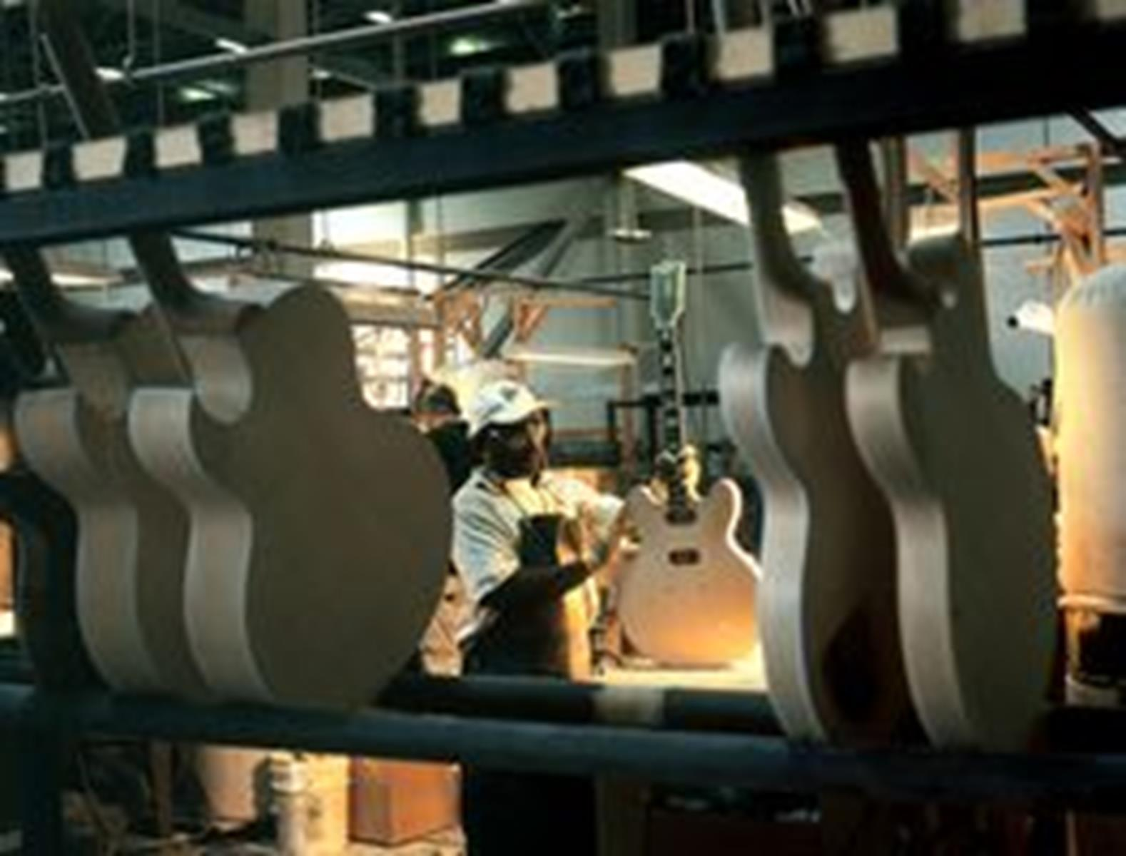 Crafting a guitar at the Gibson Guitar Factory. Photo from Memphis Convention & Visitors Bureau.