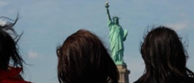 people looking at the statue of liberty