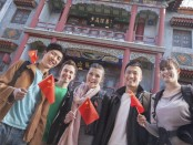 Students holding chinese flags