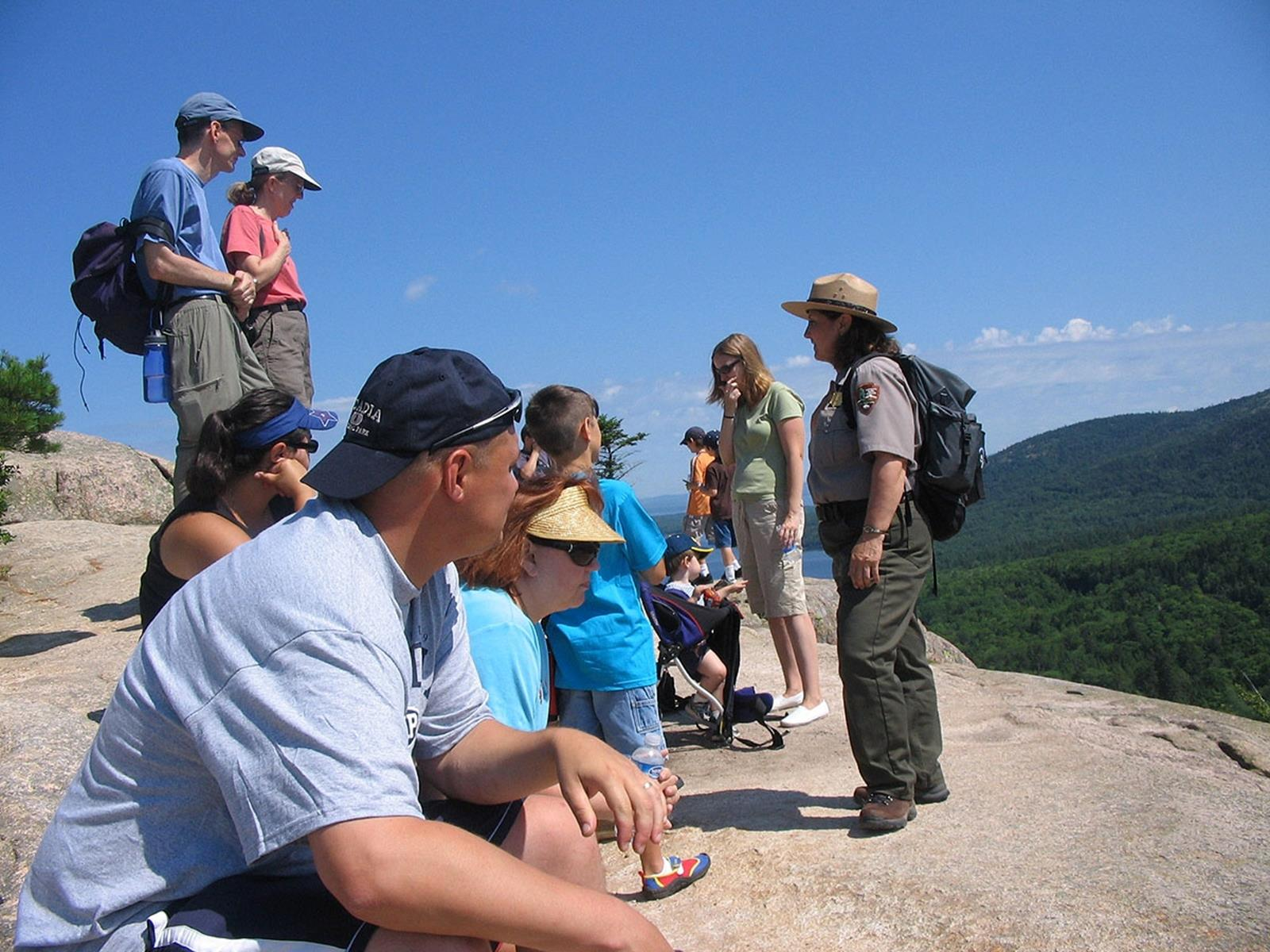 Ranger leading a Mountain Mysteries family program at Acadia National Park. Credit: National Park Service