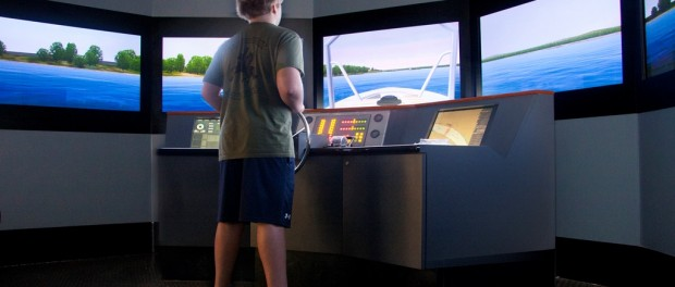 A student tries his hand at the boat simulator.