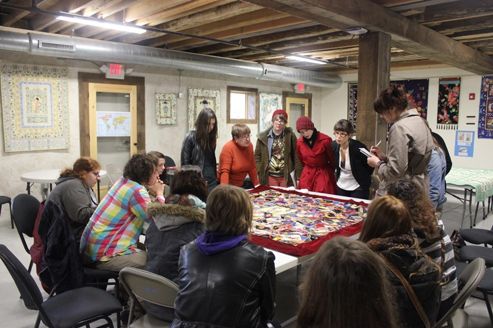 A student group designing a quilt. Credit: Wisconsin Museum of Quilts and Fiber Arts