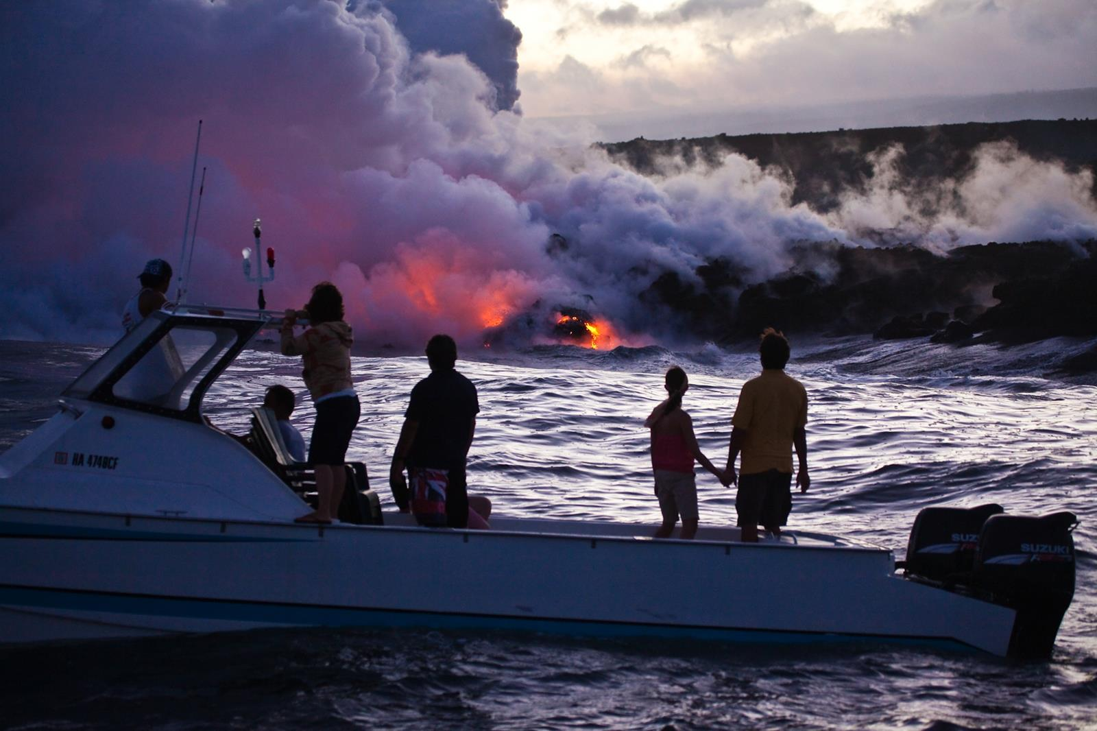 Boaters watching lava enter the ocean at Hawaii Volcanoes National Park. Credit: Hawaii Tourism Authority (HTA)/Tor Johnson Island.