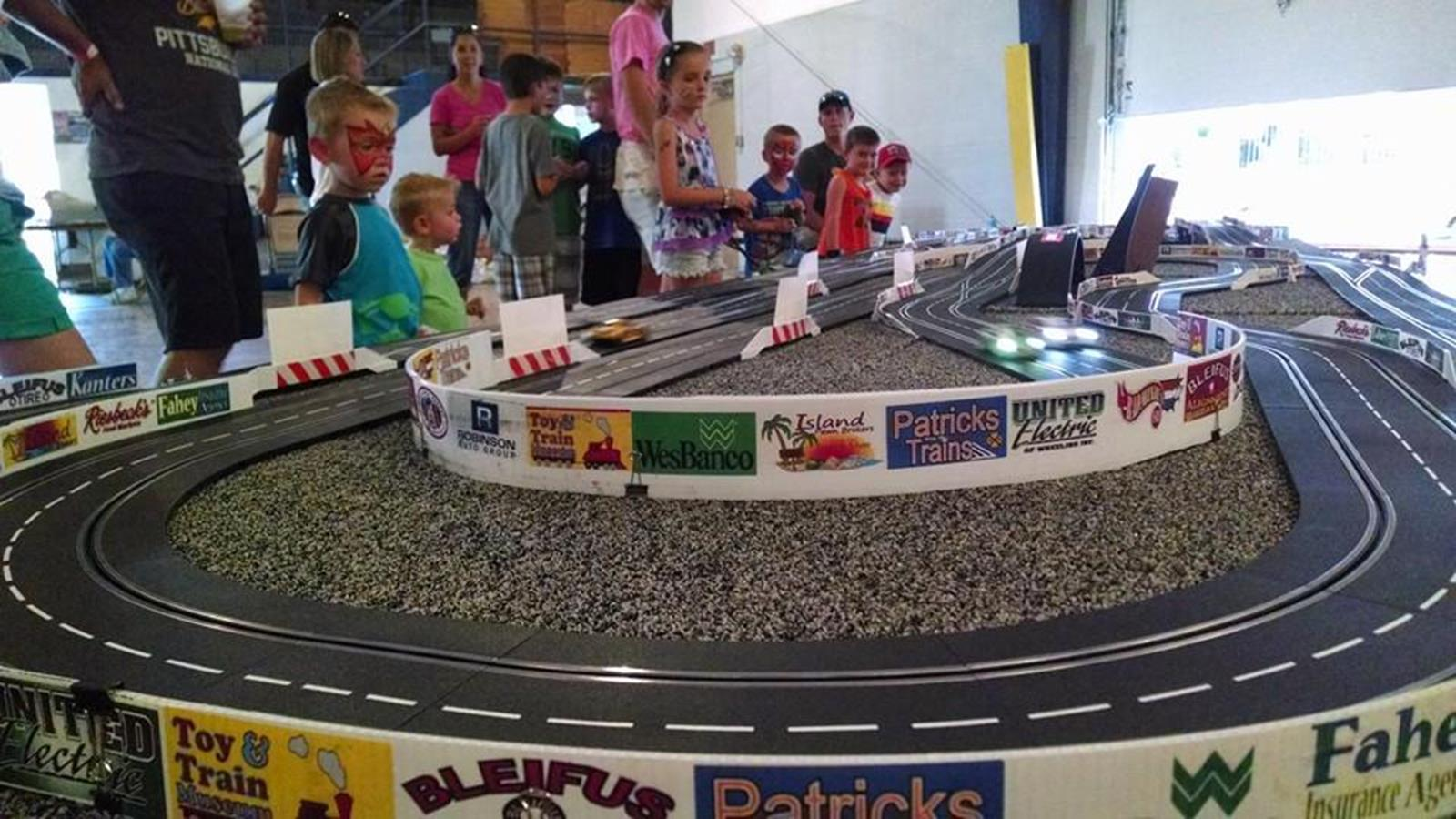 Watching the cars race. Credit: Kruger Toy and Train Museum