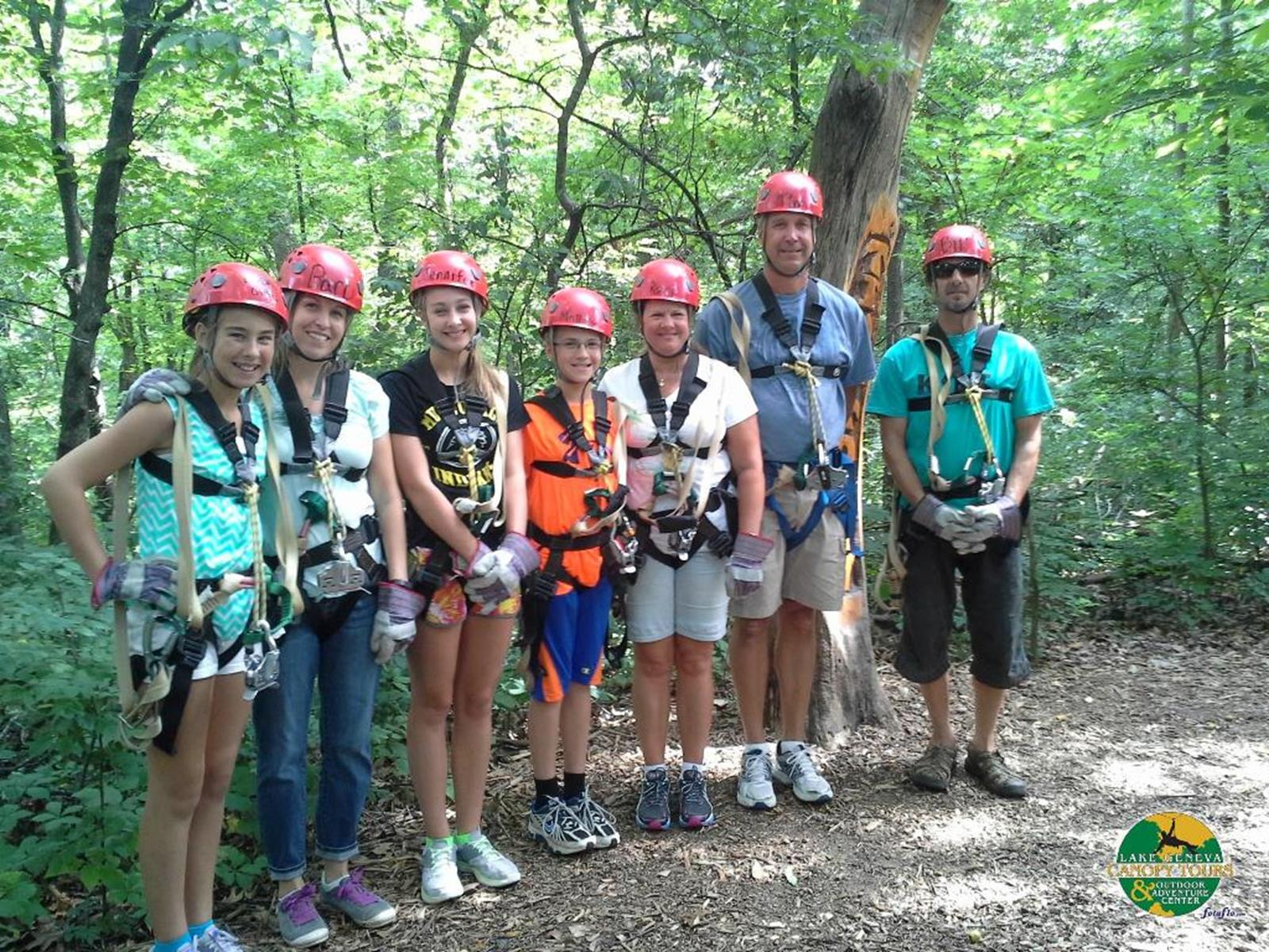 A group getting ready to zip line. Credit: Lake Geneva Canopy Tours