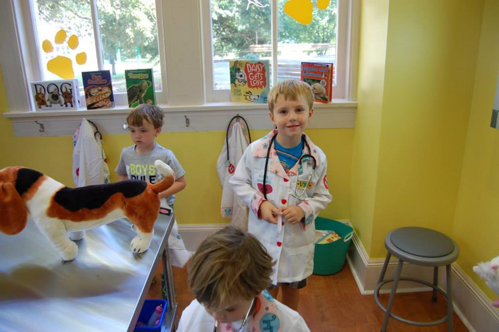 Students playing veterinarian at animal hospital exhibit. Credit: Lynn Meadows Discovery Center