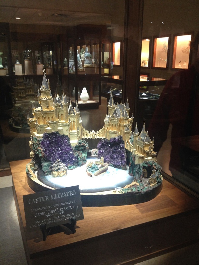 Castle Lizzadro 18k gold sculpture featuring windows of cut diamonds on a base of mineral specimens.