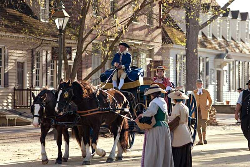 Colonial Williamsburg guests can tour Duke of Gloucester Street as passengers in a horse-drawn coach