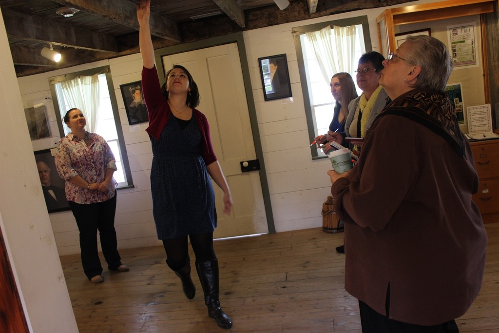 Tour guide showing the historic Sheldon Peck Homestead museum.